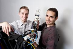 Toronto's Michal Prywata and Thiago Caires, previous winners of a Dyson Awards, with the new AMO Arm prosthetic device.