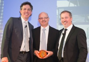 Panasonic Eco Solutions Canada Managing Director Walter Buzzelli (centre) receives Canadian Solar Industries Association Game Changer Award for Energy Management and is flanked by Gala event Co-hosts Gregory Scallen, past CanSIA Board Chair and John Gorman, President & CEO of CanSIA