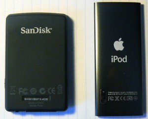 Back side view of iPod nano 5G and Sansa Fuze. Note the camera on lower left of iPod.
