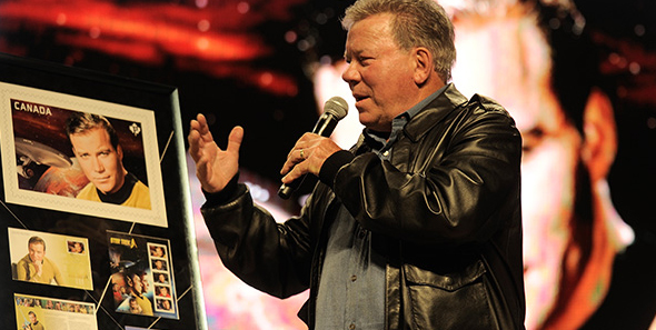 William Shatner with a framed stamp of his beloved character, Captain Kirk, at the Calgary Comic and Entertainment Expo.