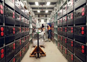rows of lithium ion batteries are stacked upon each other in this image of the Basin energy storage system.