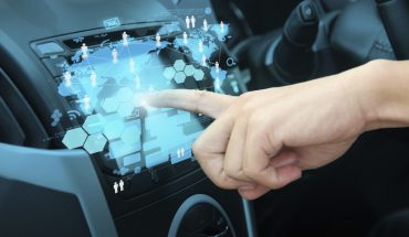 Human finger points to touchscreen on car dashboard. Want to Get Paid $33 Billion a Year? Maybe 600 Billion If Your Data Is Good