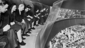 black and white photo shows people looking at high-tech display