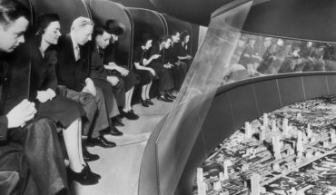 black and white photo shows people looking at high tech display