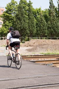 cyclist riding over railway tracks