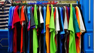 a rack of colourful t shirts