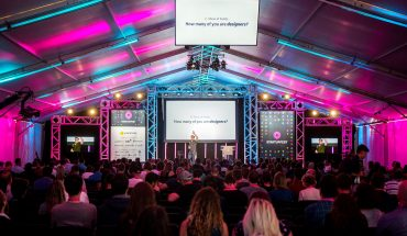 large crowd attends indoor conference event