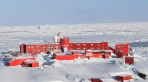 several large buildings seen on snow-shrouded landscape