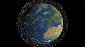 planet seen from space surrounded by satellite orbit tracks