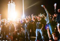 crowd holding up smartphones