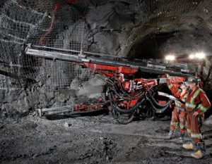 miners and machinery underground
