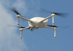drone in fight in clear bue sky
