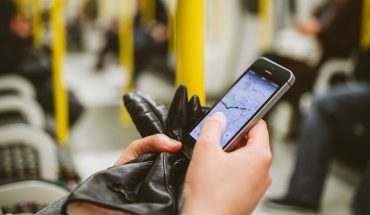 person's hands holding a smartphone
