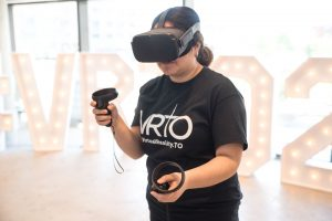 woman wears VR hedeset