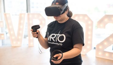 woman wearing VR headset and using hand controls