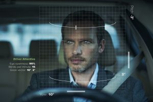 male driver seen through overlay of graphic grid and points on the eye