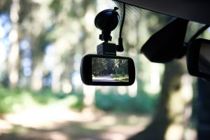 interior car scene shows dash cam and view screen