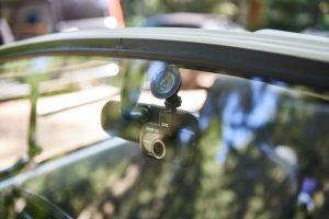 dash cam attached to rear view mirror as seen through front windshield