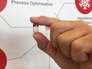 BodyCap pill in hand