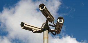 three CCTV cameras on single mounting post
