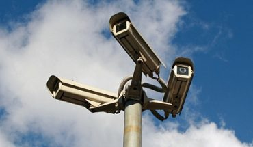 three CCTV cameras on a single mounting post