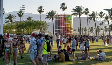 fans mingle on grassy lawn at music festival