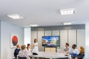 people in meeting room using Li-Fi transmission technology