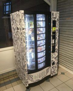 vegan vending machine has flowers drwan upon it