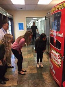people looking at vending machine