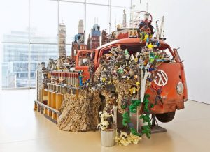 a VW bus is at the centre of a mixed-media art exhibit