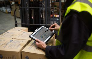warehouse person using laptop