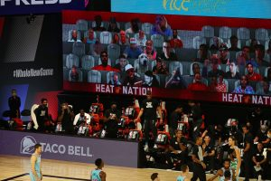 basketball players on court, virtual fans in the stands