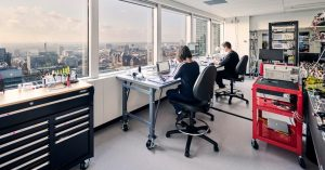 people sitting in modern office near big window