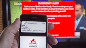 hand holds smartphone wiht alert message on screen