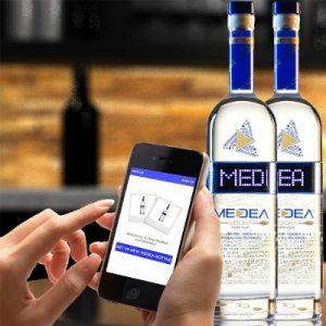 smartphone and vodka bottles