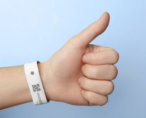 hand with wristband on gives thumbs on