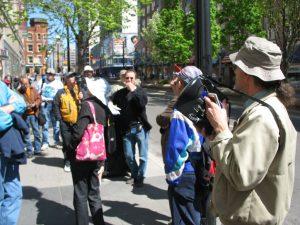 crowd of people outdoors on city sidewalk