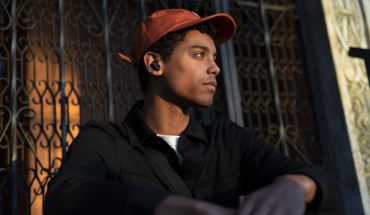 young man has earbuds on