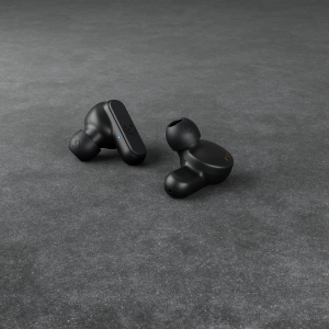 black earbuds on flat surface
