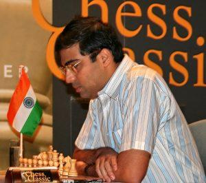 man sits at chess table