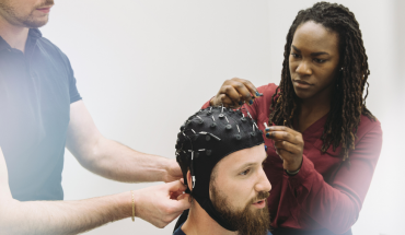 Cognitive Health Technicians from VoxNeuro running a Cognitive Health Assessment on a concussion patient. (Photo: Business Wire)
