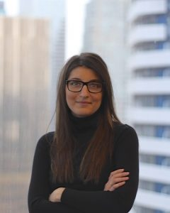 business woman standing in high rise office setting