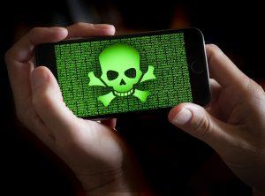 skulls and crossbones image on smartphone screen