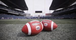 CFL footballs on field